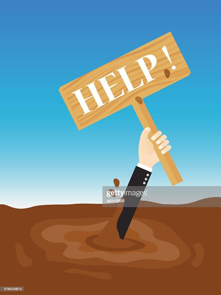 businessman sinking in quicksand holding up wooden sign need help