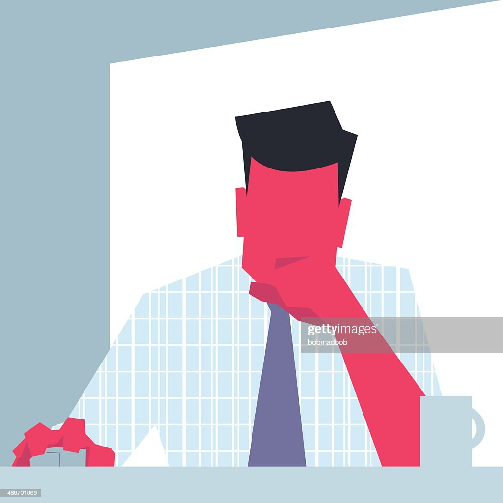 Businessman sitting in front of computer and thinking.