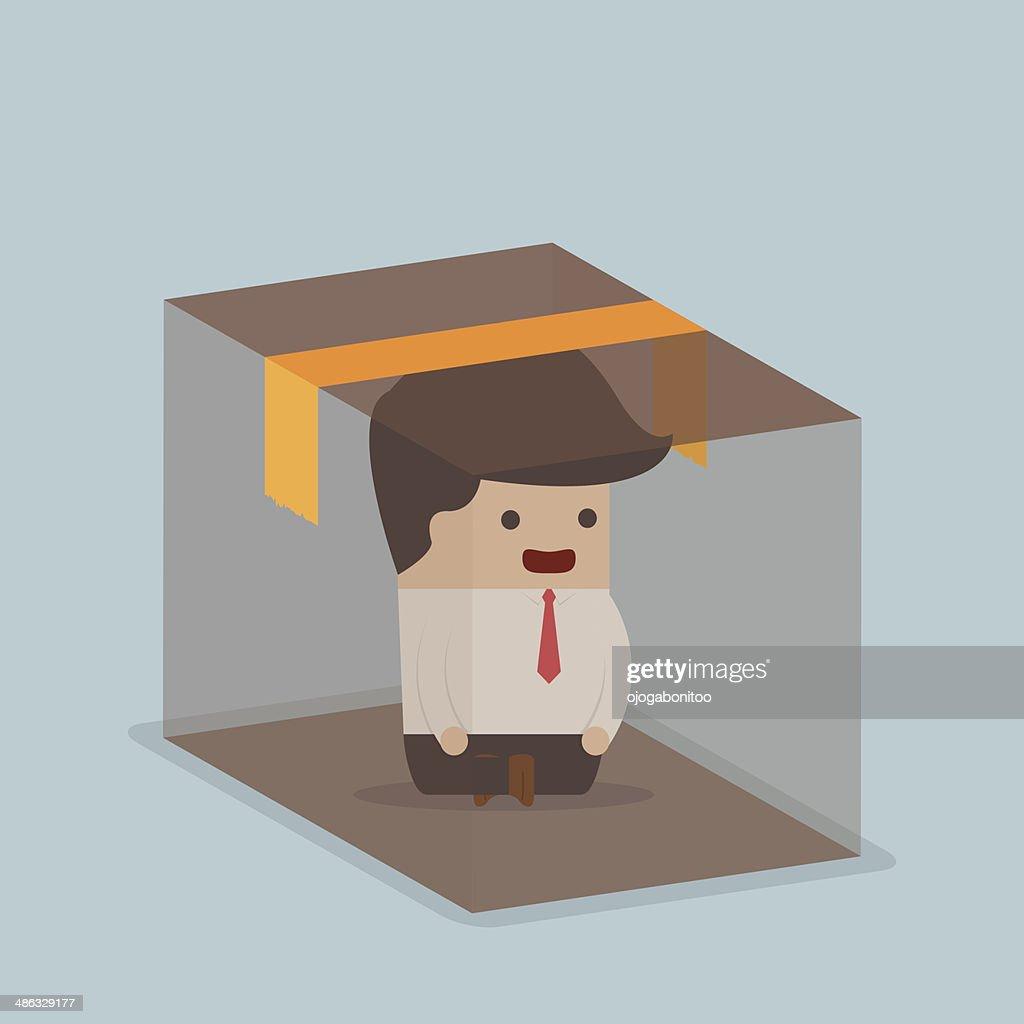 Businessman sitting inside the box