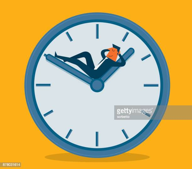 Businessman sleeping on clock