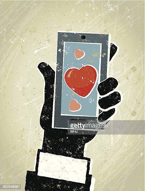 Businessman, Smart Phone and Heart. Online Dating
