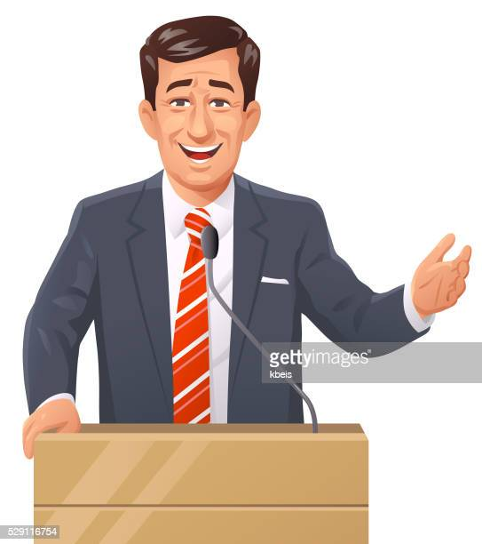 Businessman Speaking At Lectern