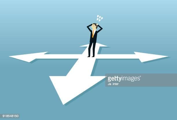 Businessman standing and choosing way