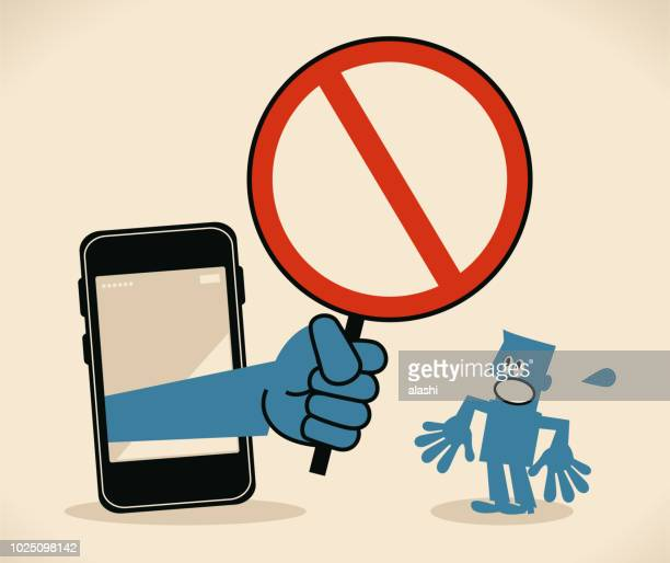 businessman standing in front of a big smart phone, a big hand from the mobile phone holding an empty prohibition sign - malfarbe stock illustrations