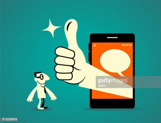 businessman standing in front of a big smart phone, big hand out from the mobile phone with thumbs up gesture (good! great!) - applauding stock illustrations, clip art, cartoons, & icons