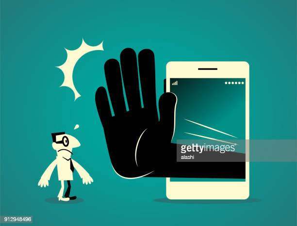 businessman standing in front of a big smart phone (mobile phone) with a big hand making stop gesture (no!) - forbidden stock illustrations