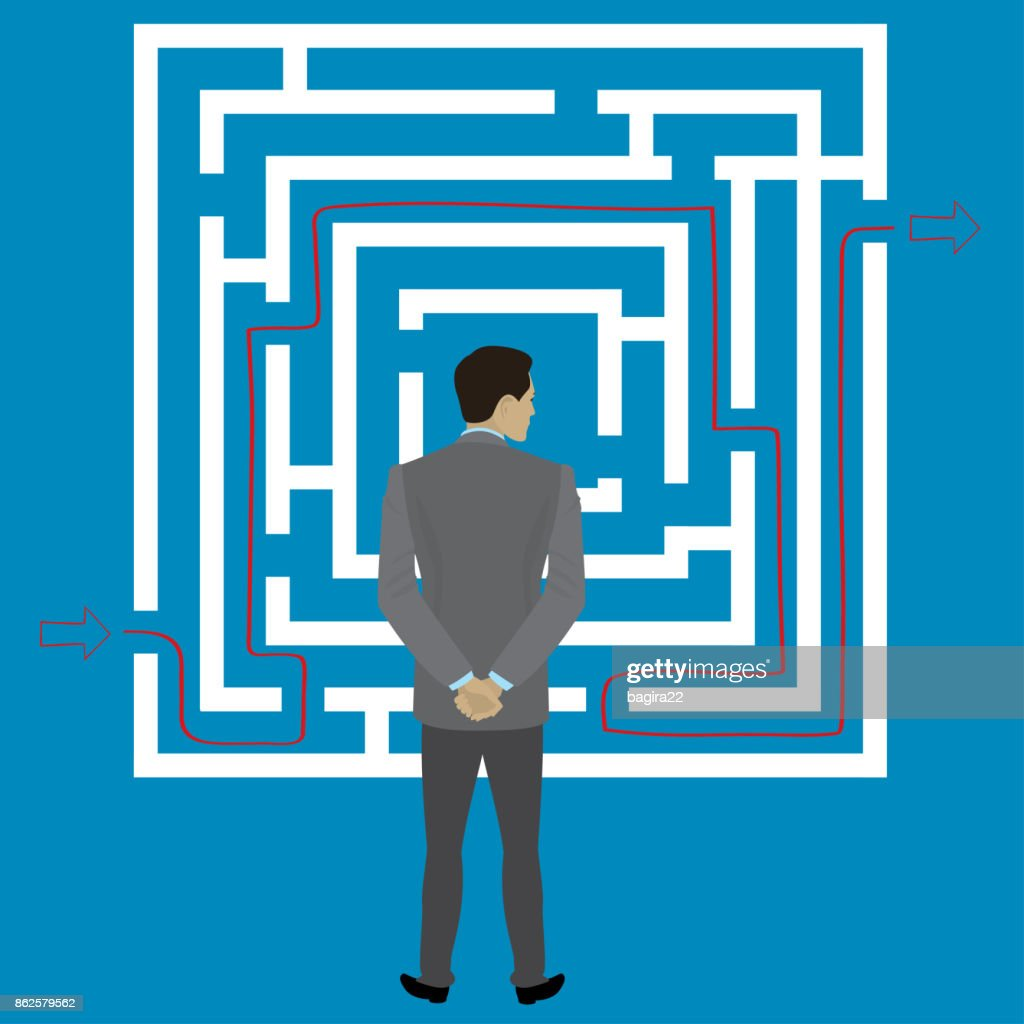 Businessman standing in front of a maze with a solution to succe