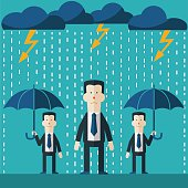Businessman standing in rain. Concept of businessman fail and competition