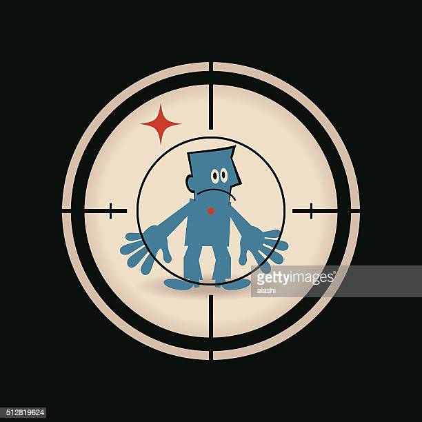 Businessman standing in the crosshairs center rifle (gun) sight