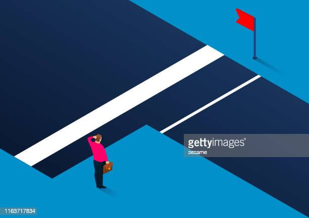 businessman standing next to the gully thinking about choosing a dangerous shortcut or choosing a distant safe way to reach the end - next stock illustrations