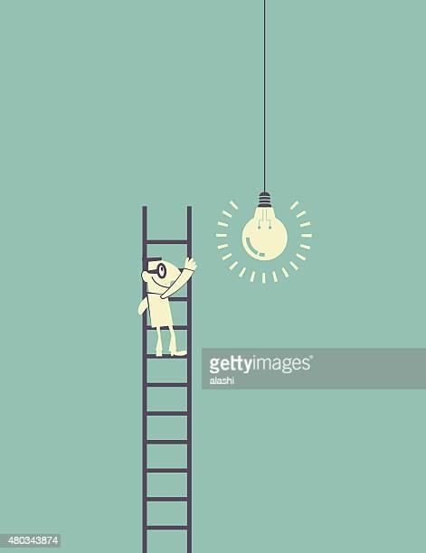 Businessman standing (climbing) on ladder catching a idea light bulb