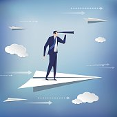 Businessman standing on the paper plane