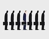 Businessman standing out from crowd.