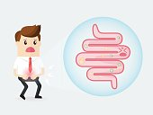 businessman  stomach ache with bacteria in the small intestine