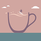 Businessman surfing in coffee cup