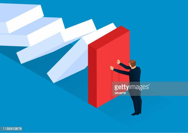 businessman trying to stop the dominoes from collapsing - adversity stock illustrations