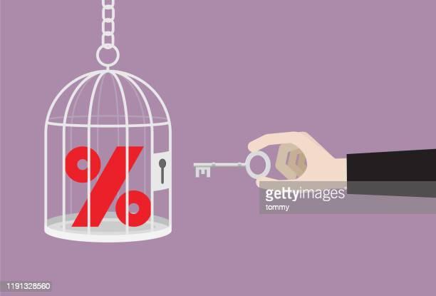 geschäftsmann verwendet einen schlüssel entsperren ein rotes prozentzeichen aus einem käfig - zinssatz stock-grafiken, -clipart, -cartoons und -symbole