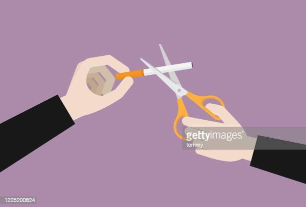 businessman using a scissor cut a cigarette - cartoon cancer stock illustrations