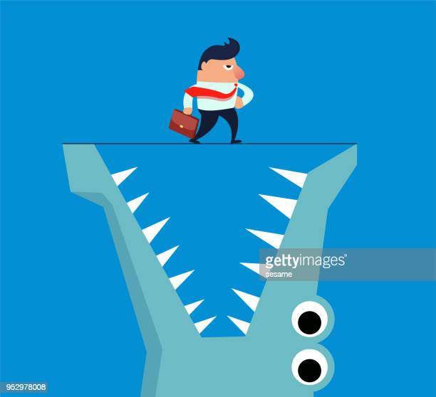 Businessman walking on crocodile mouth