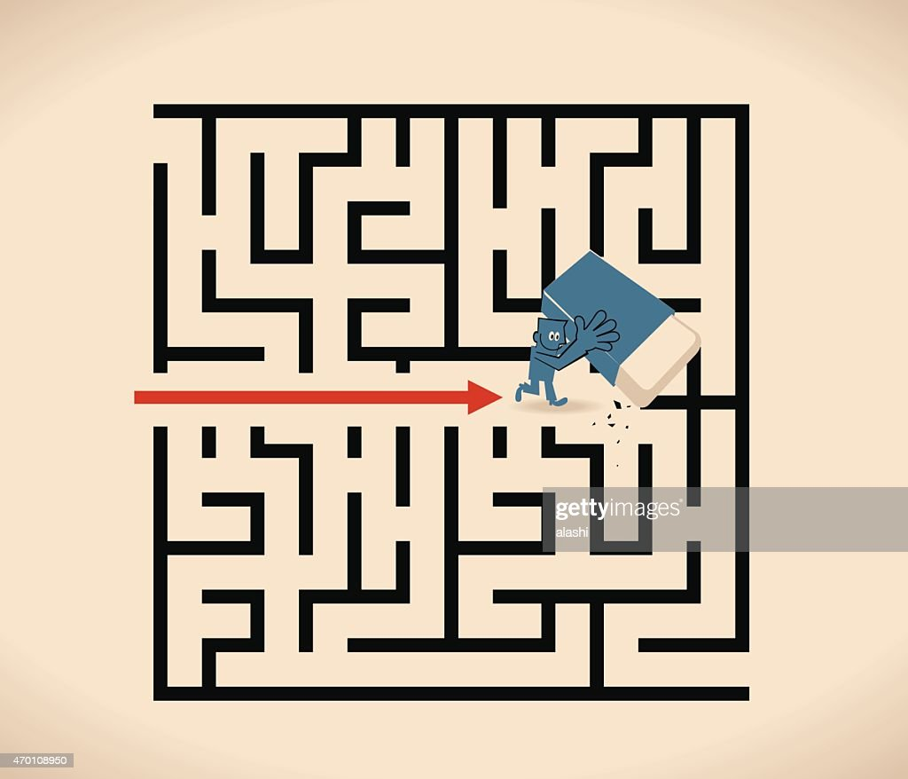 Businessman walking through a maze opened up by a eraser