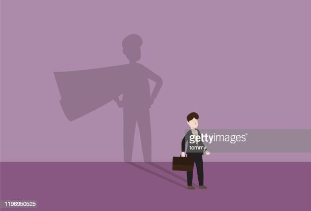 businessman with a cape shadow - heroes stock illustrations