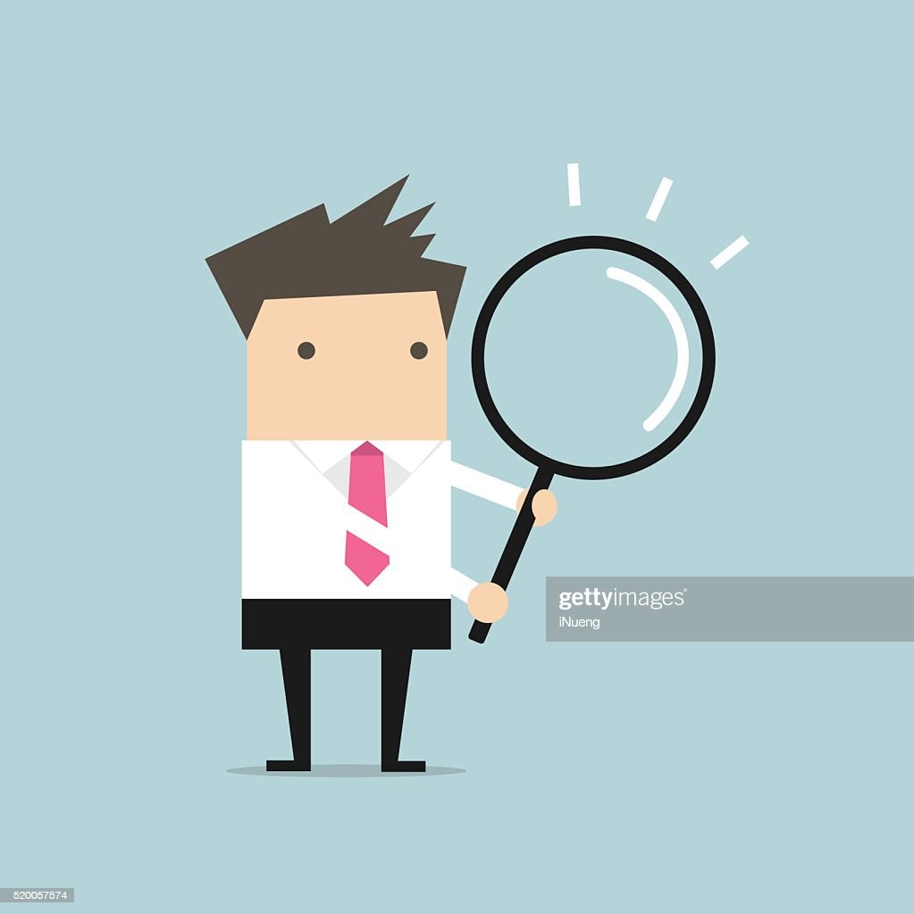 Businessman with a magnifying glass