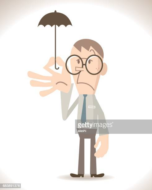 Businessman with a small umbrella