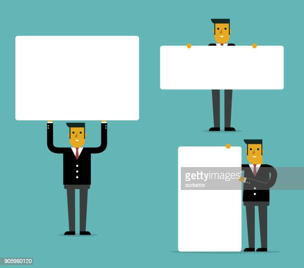 Businessman With Blank White Boards