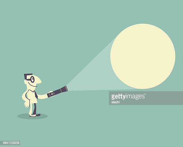 Businessman with glasses, holding a flashlight, finding something. (spotlight)