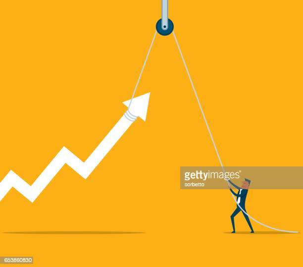 businessman with hoist up arrow