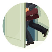 Businessman with leather briefcase exits fast through door
