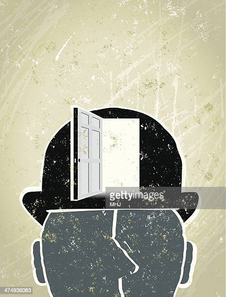 Businessman with Open Doorway in his Hat
