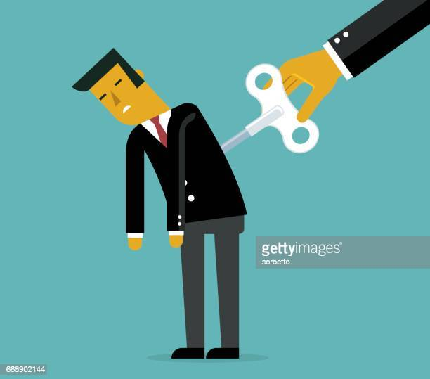 Businessman with wind-up key