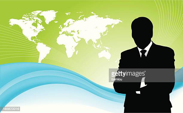 Businessman with world map in background