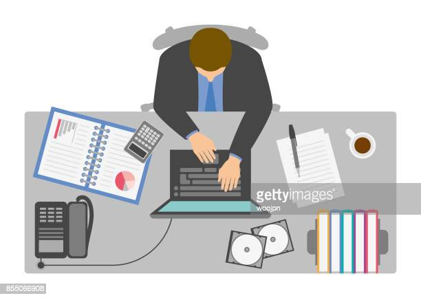 Businessman working at desk from above