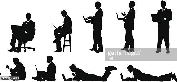 businessman working on laptop sitting standing and lying down - clip art stock illustrations