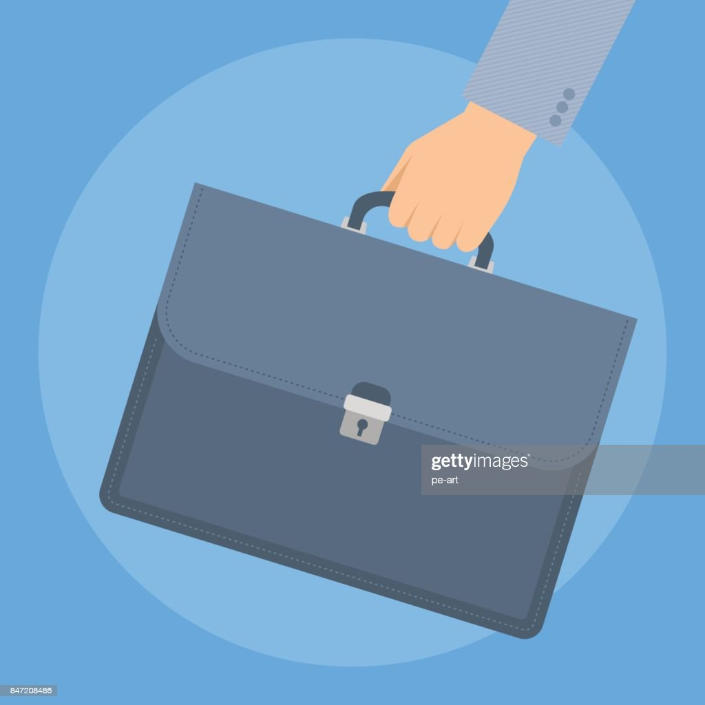 Businessman's hand with briefcase.