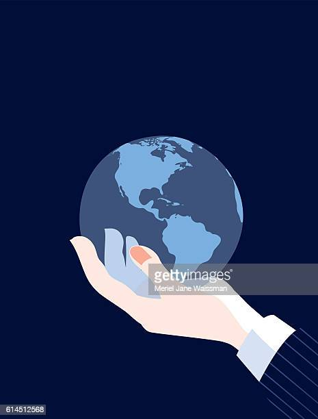 Businessman's Hand World Holding Globe Map Showing The Americas