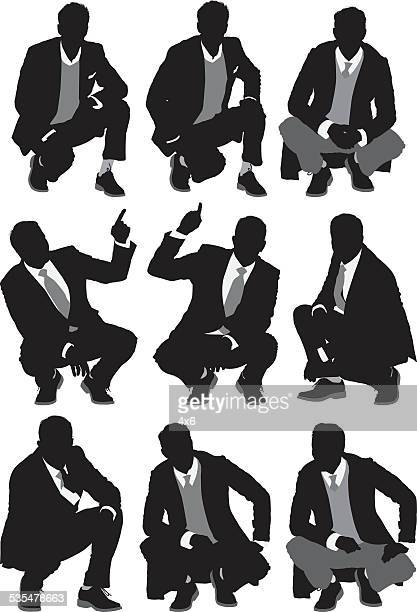 businessmen crouching - crouching stock illustrations, clip art, cartoons, & icons