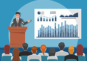 Businessmen giving speech or presenting charts on a whiteboard