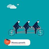 Businessmen on tandem bike with money sign