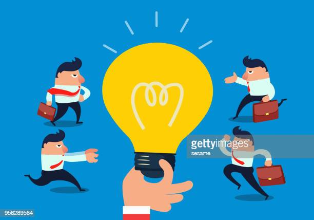 Businessmen running together light bulbs in giant hands