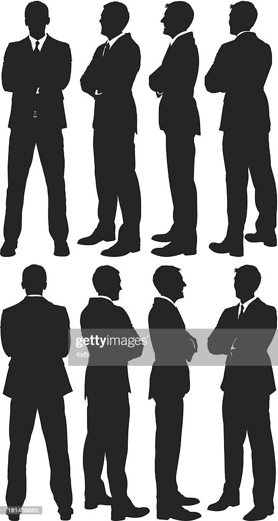 Businessmen standing with arms crossed
