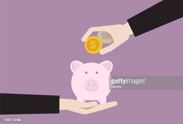 ilustrações de stock, clip art, desenhos animados e ícones de businesspeople putting dollar coin into a piggy bank - colocar