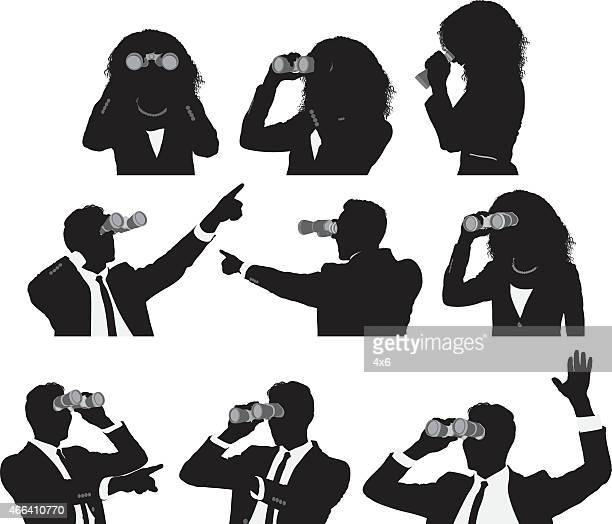 Businesspeople using binocular
