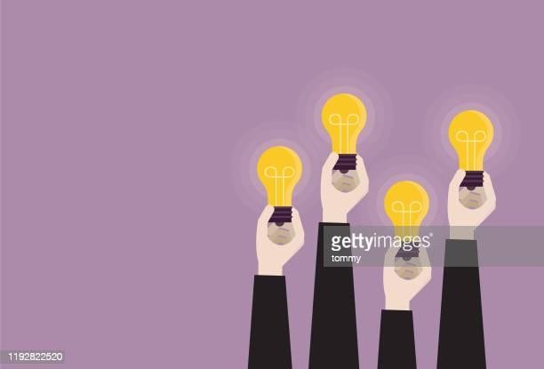 illustrazioni stock, clip art, cartoni animati e icone di tendenza di uomo d'affari che tiene insieme una lampadina - proprietà intellettuale