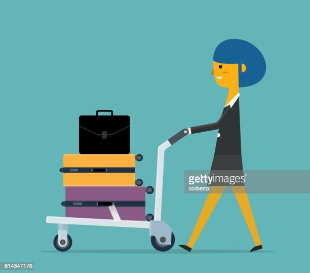 Businesswoman at the Airport with Luggage Cart