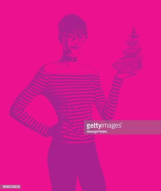 Businesswoman holding rock cairn