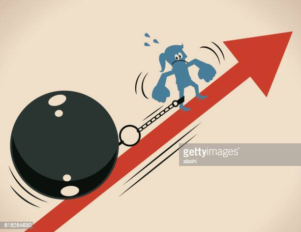 Businesswoman (woman, girl, prisoner) is locked in a big iron ball and chain, she is struggling to escape from it and moving up on the up raising arrow symbol