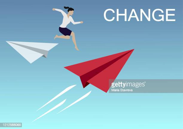 businesswoman jump from white origami paper airplane to red for change direction. business concept of changing. - change stock illustrations